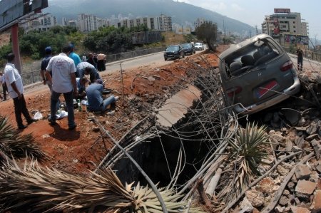 Beirut, Lebanon-August 4, 2006: A bridge damaged by Israeli bombings in 2006, overlooking a highway south of Beirut on August 4, 2006, Beirut,Lebanon.                                                             Stock Photo - 17392765