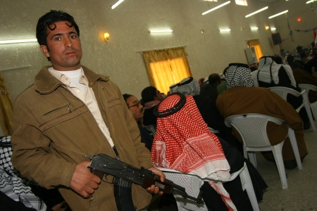 militant: Kirkuk, Iraq-February 3, 2007: Unidentifield Arab militant regarding the safety in the Arabic Culture Center on February 3, 2007 in Kirkuk,Iraq.