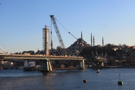 ISTANBUL, TURKEY-    The ongoing construction of the Golden Horn Metro Bridge has been criticized for breaking city s skyline  in Istanbul,Turkey  Stock Photo - 18306351