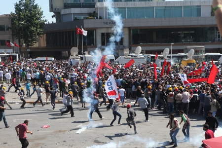 saia: ISTANBUL,TURKEY-JUN E 1: Protesters in Taksim continue as minor scuffles break out and protesters lob fireworks at officers. Police removed barricades around the square on June 1,2013 in Istanbul.