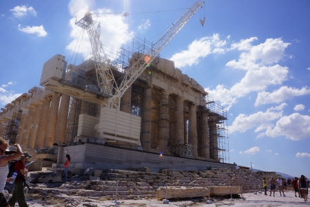 demos: ATHENS, GREECE - JULY 23  Tourists in famous old city Acropolis Parthenon Temple on July 23, 2013 in Athens, Greece  Construction began in 447 BC in the Athenian Empire  It was completed in 438 BC
