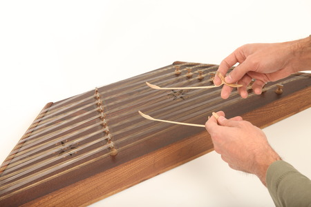 fingering: Santur is an Iranian hammered dulcimer