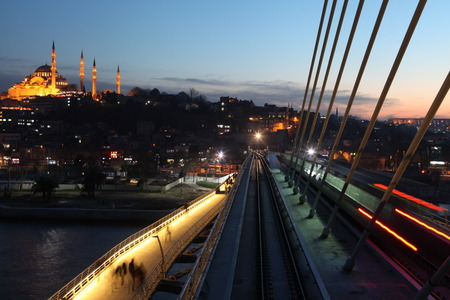 Istanbul's new metro bridge was put into service has been criticized for breaking city s skyline  photo