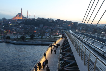Istanbul�s new metro bridge was put into service has been criticized for breaking city s skyline  photo