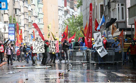 ISTANBUL, TURKEY-MAY 1  Turkish police fired water cannon and tear gas to prevent protesters from defying a ban on May Day rallies and reaching Taksim Square on May 1, 2014 in Istanbul, Turkey