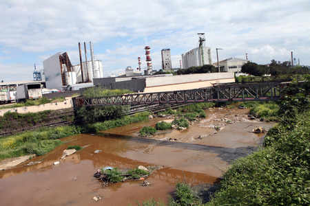 A river polluted with waste from a nearby factory