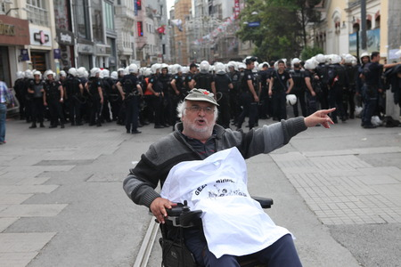 arrestment: ISTANBUL,TURKEY-MAY 31  Police use tear gas and water cannons on the tense one year anniversary of the Gezi park protests which sparked wider unrest throughout Turkey on May 31,2014 in Istanbul,Turkey Editorial