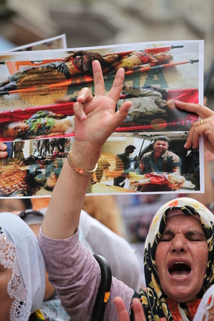 massacre: Kurdish people marched in Taksim today to protest massacre by Isil in Iraq Editorial