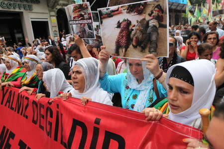 marched: Kurdish people marched in Taksim today to protest massacre by Isil in Iraq Editorial