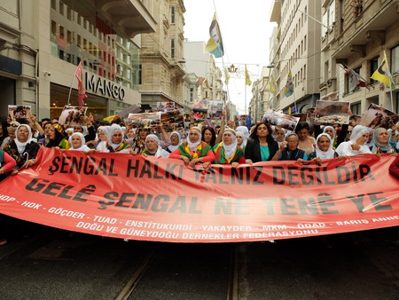 politican: Kurdish people marched in Taksim today to protest massacre by Isil in Iraq Editorial