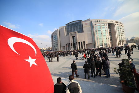 detain: Istanbul,Turkey-December 14,2014:Turkish police raid Zaman building, attempt to detain editor. A crowd of protesters forced police to turn back before they could make arrests on December 14, 2014 in Istanbul.