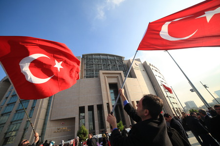 arrests: Istanbul,Turkey-December 14,2014:Turkish police raid Zaman building, attempt to detain editor. A crowd of protesters forced police to turn back before they could make arrests on December 14, 2014 in Istanbul.