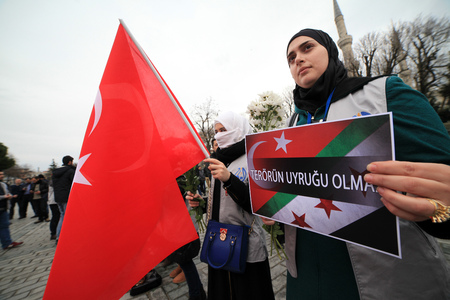 ISTANBUL,TURKEY-JANUARY 16 :  Syrians, living in Turkey, memorized for tourists who died the Sultanahmet suicide attack the site of Sultanahmet attack on January 16, 2016 in Istanbul,Turkey.