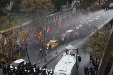 disperse: ISTANBUL,TURKEY-NOV 5 : Riot police use water cannons to disperse protesters during a protest against the arrest of pro-Kurdish Peoples Democratic Party (HDP) lawmakers, in Istanbul, November 5, 2016 Editorial