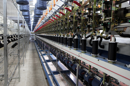 hosiery: Textile fabric manufacturing machines in work. Textile industry.