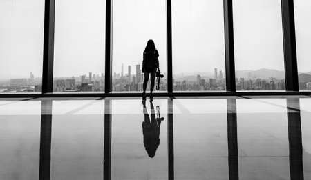 high rise buildings: a lady looking out at the high rise buildings