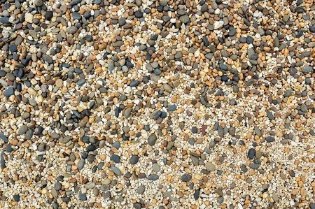 untidy: Wide angle view of small pebbles beside the sea
