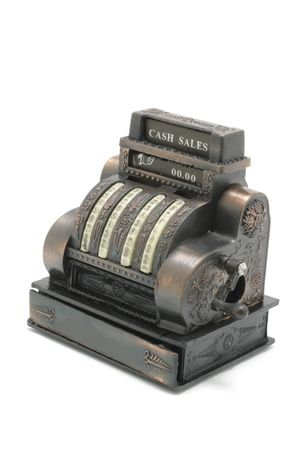 miniature cash register on white background photo
