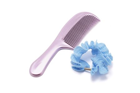 scrunchy: Comb and Hair Scrunchy on white Background Stock Photo