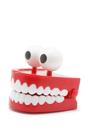 chuckle: Chattering Teeth on White Background