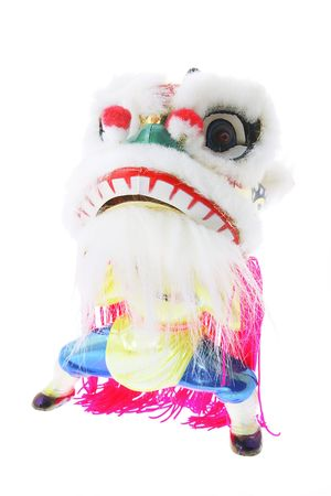 lion figurines: Miniature Lion Dance Ornament on White Background Stock Photo