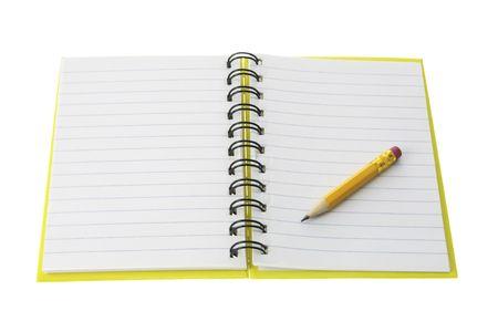 note book: Matita breve nota sul libro aperto su sfondo bianco  Archivio Fotografico