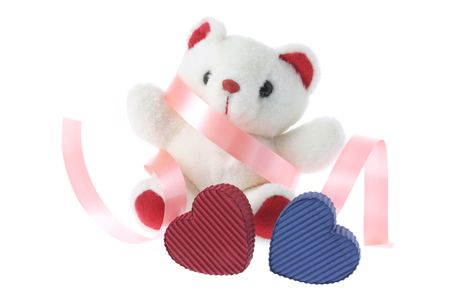 Teddy Bear and Gift Boxes on White Background photo