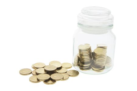 legal tender: Coins in Glass Jar on White Background
