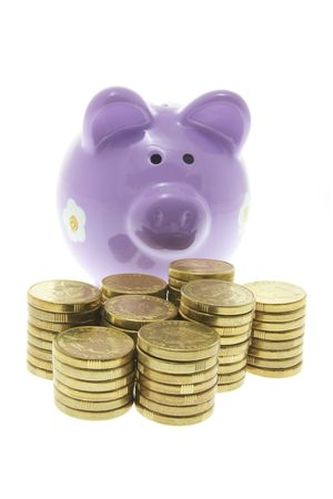 Piggy Bank with Stacks of Coins on White Background photo