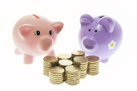 Piggy Banks with Coins on White Background photo
