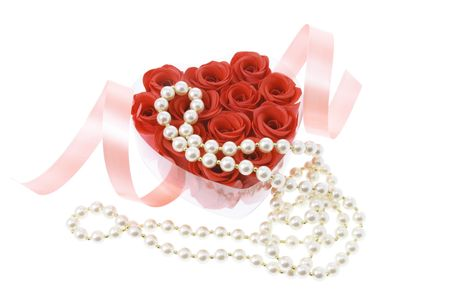 Pearl Necklace and Red Roses on White Background photo