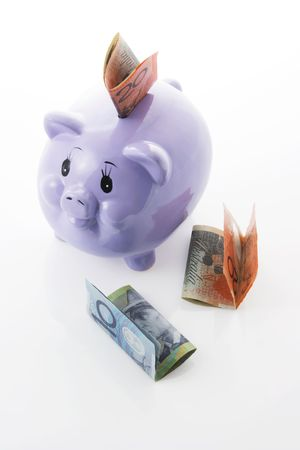Piggy Bank with Dollar Notes on Seamless White Background Stock Photo - 3532551
