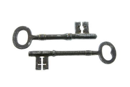 Two Skeleton Keys on White Background photo