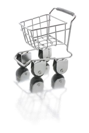 Miniature Shopping Trolley with Reflection on White Background photo