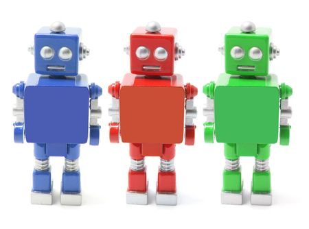 Toy Robots Standing on White Background photo