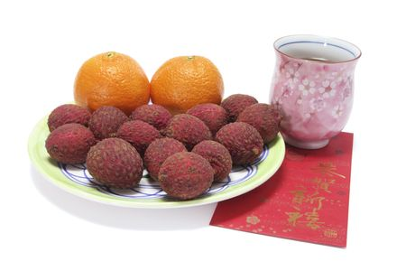 Chinese New Year Fruits and Drink on White Background photo