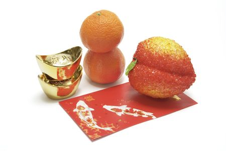 Gold Ingots, Mandarins and Peach on Red Packet photo