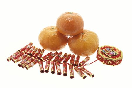 fire crackers: Fire Crackers and Mandarins on White Background