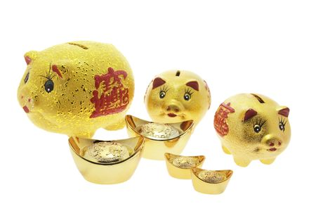 Piggy Banks and Gold Nuggets on White Background photo