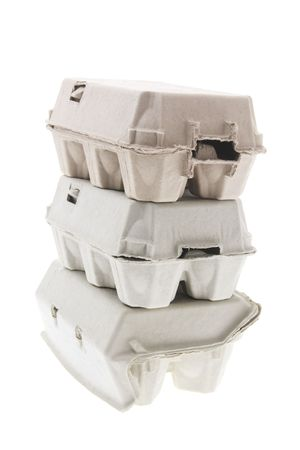 Stack of Egg Cartons on White Background photo