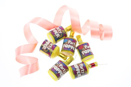 poppers: Party Poppers and Curling Ribbon on White Background Stock Photo