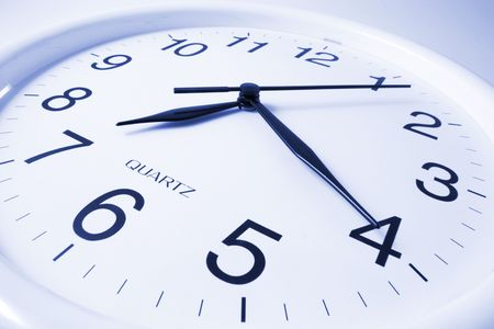 precisely: Close Up of Wall Clock in Blue Tone