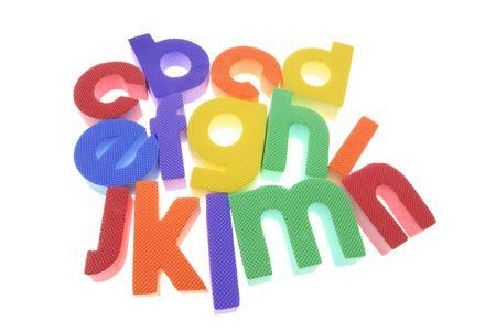 isol� sur fond blanc: Alphabets color�s sur fond blanc isol� Banque d'images