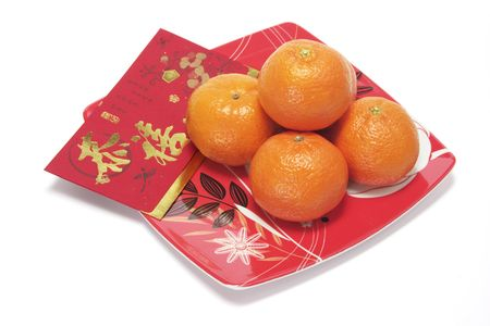 red packet: Red Packet and Mandarins on Red Plate Stock Photo