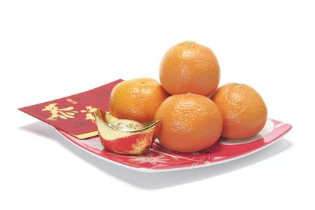 Mandarins, Gold Ingot and Red Packet on Plate photo