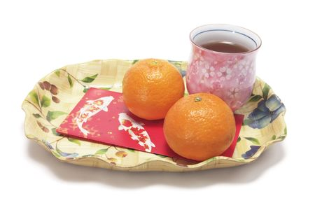 Mandarins, Red Packet and Cup of Chinese Tea photo