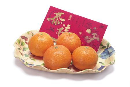 Mandarins and Red Packet on White Background photo