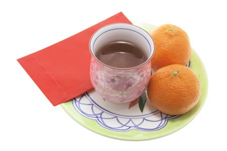 Teacup, Mandarins and Red Packet photo