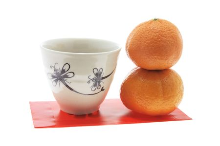 red packet: Mandarins; Teacup and Red Packet Stock Photo