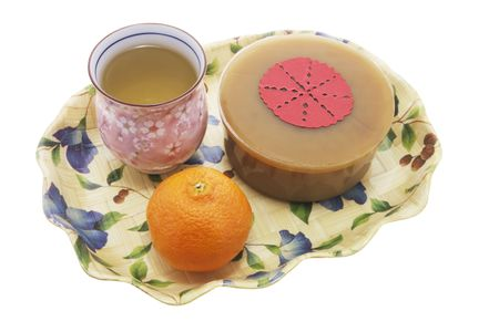 Mandarin, Teacup and Chinese New Year Cake photo